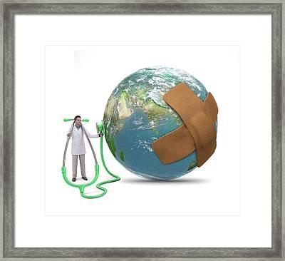 Doctor Examining Earth Framed Print by Andrzej Wojcicki
