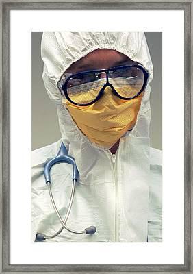 Doctor In Biohazard Suit Framed Print
