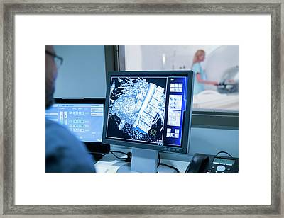 Doctor Looking At Mri Scans On Monitor Framed Print by Science Photo Library