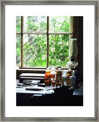 Framed Print featuring the photograph Doctor - Medicine And Hurricane Lamp by Susan Savad