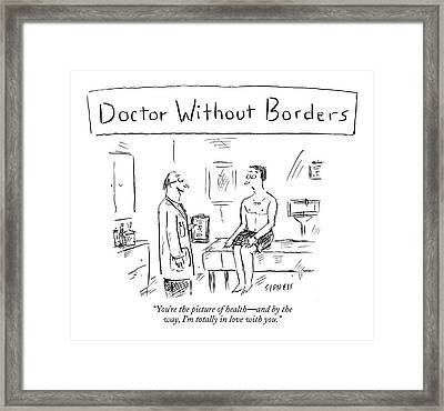 Doctor Talking To Patient On Examing Table Framed Print