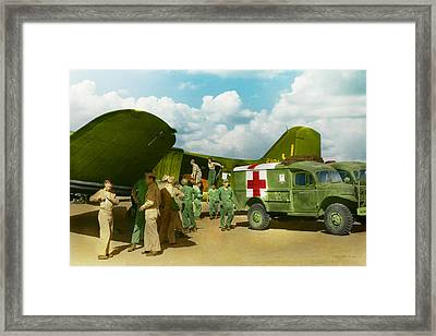 Doctor  - Transferring The Wounded Framed Print by Mike Savad