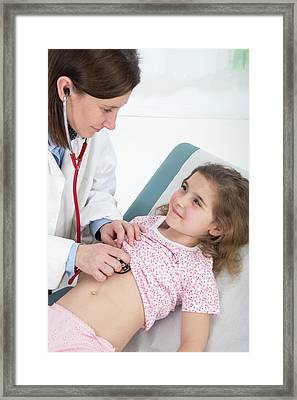 Doctor Using Stethoscope Framed Print by Lea Paterson