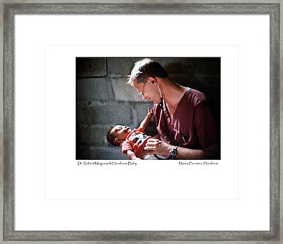 Doctor With Honduran Baby Framed Print