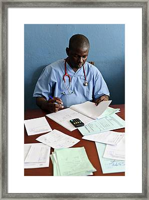 Doctor With Patient Notes Framed Print