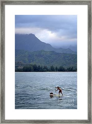 Dog And Man Paddleboarding In Hanalei Bay Framed Print