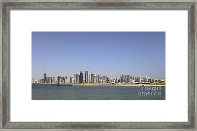 Doha Skyline Panorama Framed Print by Paul Cowan