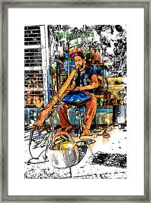 Doing The Didgeridoo Framed Print by John Haldane