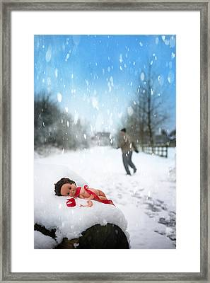 Doll Abandoned In Snow Framed Print by Amanda Elwell