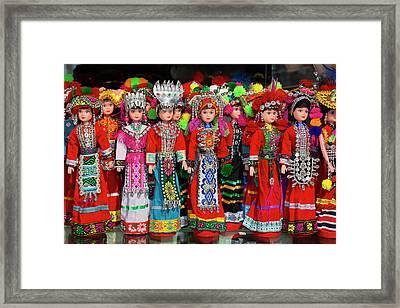 Dolls On Display In Ethnic Native Framed Print by Darrell Gulin