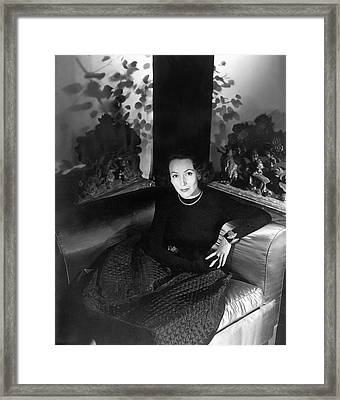 Dolores Del Rio Sitting In An Armchair Framed Print by Horst P. Horst