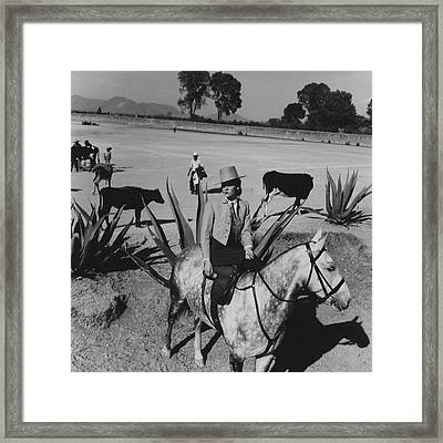 Dolores L. Corcuera Riding Side-saddle Framed Print