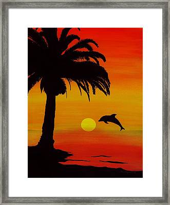 Dolphin Sunset Framed Print by Barbara St Jean