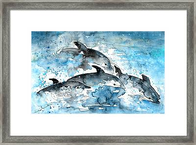 Dolphins In Gran Canaria Framed Print by Miki De Goodaboom