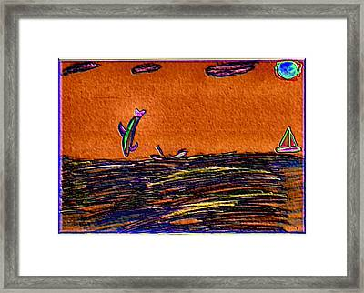 Dolphins Playing In The Ocean Framed Print by Skyler Tipton