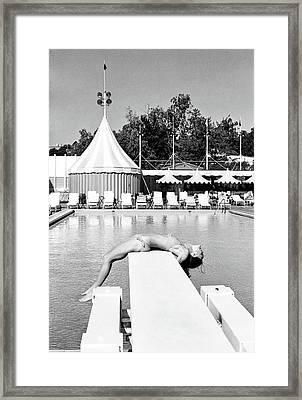 Donna Garrett Lying On A Diving Board Framed Print