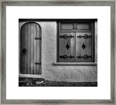 Door In Alley Framed Print