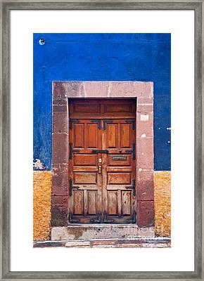 Door In Blue And Yellow Wall Framed Print by Oscar Gutierrez