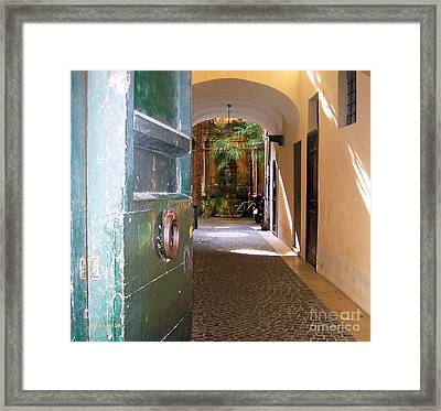 Door In Florence Framed Print by Debby Pueschel