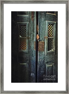 Door Peeking Framed Print by Carlos Caetano