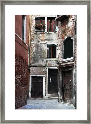 Doors Of All Sizes Framed Print by John Rizzuto