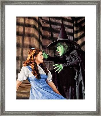 Dorothy And The Wicked Witch Framed Print