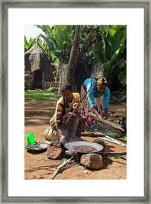 Dorse Woman Roasts Coffee Bean Framed Print by Photostock-israel