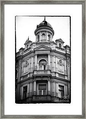 Double Balconies In Prague Framed Print by John Rizzuto