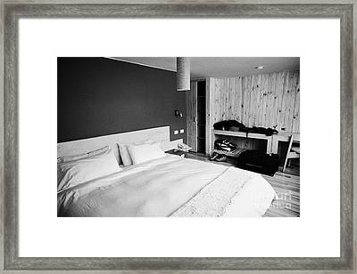 double bed in a new boutique hotel with luggage in the room in Punta Arenas Chile Framed Print by Joe Fox
