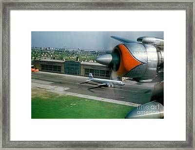 Douglas Dc-7 Taking Off Framed Print by Wernher Krutein