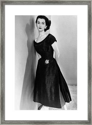 Dovima Wearing A Larry Aldrich Dress Framed Print by Horst P. Horst