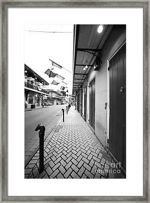 Down Bourbon Street Framed Print by John Rizzuto