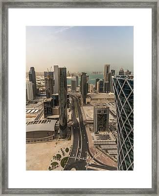 Down On Doha Framed Print by Charlie Tash