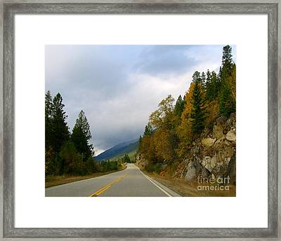 Down The Highway Framed Print by Leone Lund