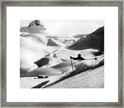Downhill Skiing In A Flurry Framed Print by Underwood Archives