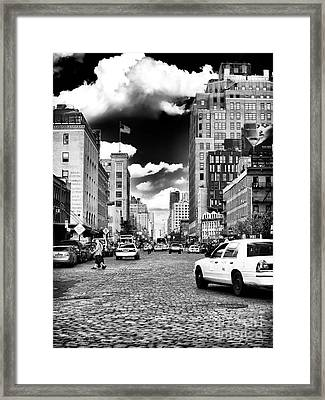 Downtown Cab Ride Framed Print by John Rizzuto