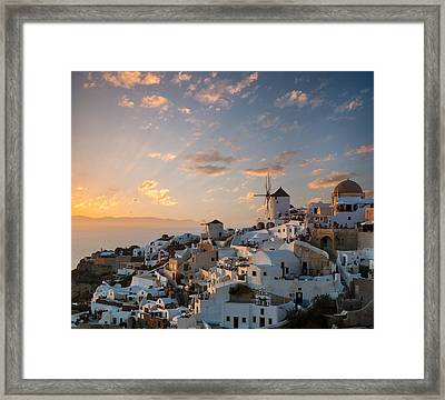 Dramatic Sunset Over The Windmills Of Oia Village In Santorini Framed Print by Gurgen Bakhshetsyan