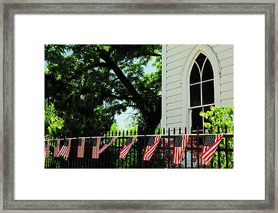 Draped Flags On Fence Of Church, July Framed Print