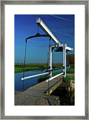 Framed Print featuring the photograph Drawbridge At Zaanse Schans by Jonah  Anderson