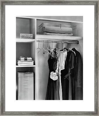 Dresses Hanging In A Closet Framed Print by Dana B. Merrill