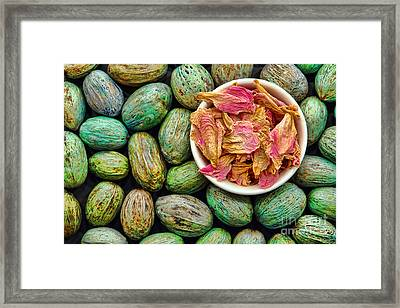Dried Flower Petals In A Dish Framed Print by Olivier Le Queinec