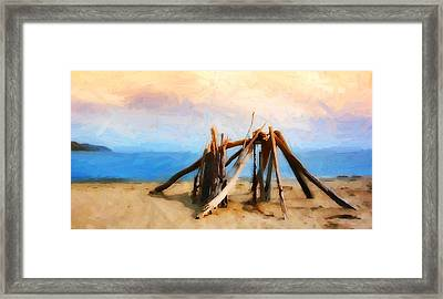 Driftwood Sculpture At Rincon Framed Print by Ron Regalado