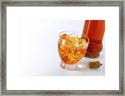 Drink On The Rocks Framed Print by Carlos Caetano