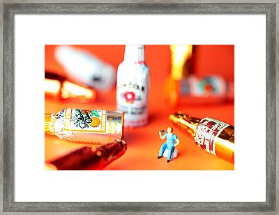 Drinking Among Liquor Filled Chocolate Bottles Framed Print by Paul Ge