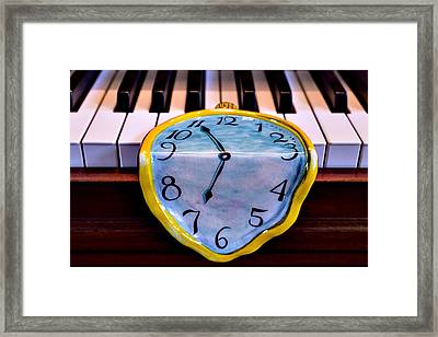 Dripping Clock On Piano Keys Framed Print by Garry Gay