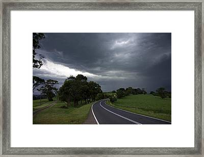 Driving Into A Storm Framed Print by Lee Stickels