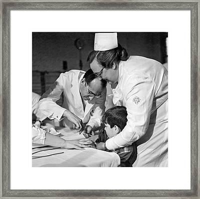 Dr.jonas Salk Giving Vaccine Framed Print by Underwood Archives