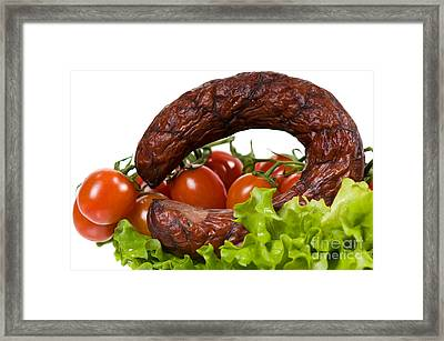 Sausage Lying On Lettuce With Red Cherry Tomato  Framed Print by Arletta Cwalina