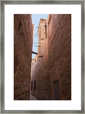 Dubai Alley With Wind Tower. Framed Print by Mark Williamson
