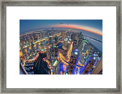 Dubai Colors Of Night Framed Print by Sanjay Pradhan
